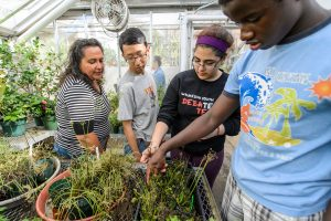 Students from PEOPLE program visit the Botany Greenhouse
